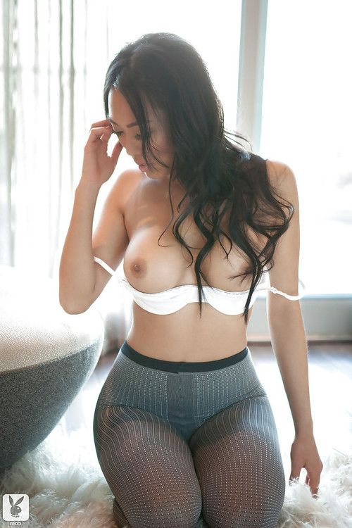 Sexy Chinese lass Kitty Lee stripping off her lingerie and pantyhose