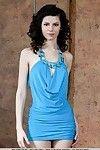 Thin dark haired glam model Swan A unveiling skinhead slit underside dress