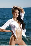 Wet and skinny Olga M modeling naked on beach for glamour discharge