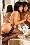 Voluptuous brunette Katcha Novak posing in panties and stockings