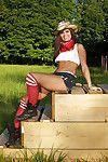 Svelte brunette babe Tierra Lee erotic dancing off her clothes outdoor