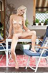 Perfect blonde Karina O takes off lingerie and shows muff close up