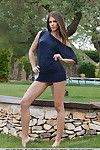 Brunette chick Caprice A opening long legs outdoors to expose vagina