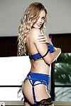 Centerfold pornstar Georgie Gee standing in her sexy blue stockings
