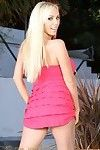 Sexy busty pornstar, Mary Carey, poses outside in her flirty pink dress and black panties! She gets so turned on that she just has to strip and reveal her hot body!