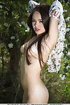 Euro babe Li Moon spreading shaved teen gentile for outdoor glam pictures
