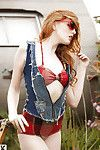 Luscious redhead with pale skin uncovering her dainty curves outdoor