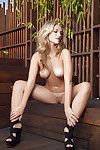 Charming blonde with graceful body Charlotte Rose posing stripped outdoor