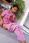 Amateur ebon beauty bares shaved youthful pussy after shedding nurse uniform