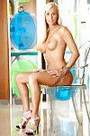 Nice-looking blonde with long legs Kristen Bennett taking off her lingerie