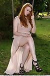 Redheaded teen Kloe Kane revealing entire young girl breasts in park