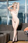 Blonde centerfold gal Dorothy Recompense letting colossal love melons discharge from underwear
