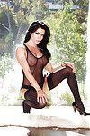 Bosomy brunette babe Elena Romanova slipping off her sheer lingerie