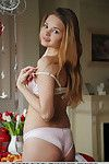 Glamorous young female Colleen A taking off underwear and panties to example in nude
