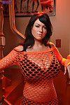 Rounded brunette beauty Rachel pose in fishnet dress for holloween