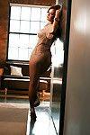 Busty hottie on high heels Leanna Decker posing barely dressed