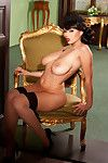 Lovely busty Dominno drops corset and shows sweet shaved fur pie