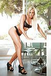 Blond teen Lindsay Love posing in black bra and panties for centerfold