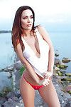 European centerfold model Adrienn Levai posing sexily outdoors