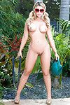 Sweaty blonde centerfold model Dorothy Reward posing bare bottomed outdoors