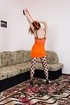 Viola R stands beautifully in her orange dress and stockings. Sliding the dress off shows us her hirsute slit in duration her panties. Last of all all naked, she spreads her legs and shows off her hirsute bush here.