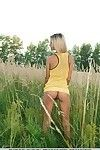 Slim blonde babe Taylor undresses and spreads her vagina outdoors