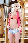 Blonde Euro babe Candee Licious freeing phat teen pornstar ass from underwear