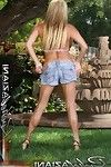 Feeling smokin\' hawt in her little halter dom and jean shorts, busty blonde Rachel Aziani gets so turned on she just has to expose her body to all.