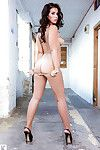 Big milk cans centerfold babe Geena is undressing in her high heels