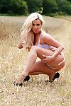 Blonde bombshell Dannii Harwood takes a stroll out in the country in some pretty white lingerie, and right after feeling the heat decides to make it a naked outdoor adventure!