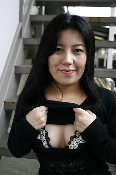 Smiley eastern ready lady undressing and teasing her bushy gash
