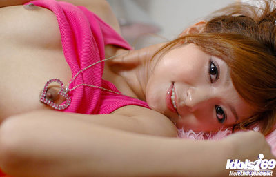 Loveable oriental amateur doll leisurely uncovering her miniature changes direction