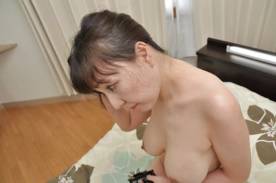 Sensuous Japanese MILF Kuniko Hara gives a titjob and acquires screwed rough