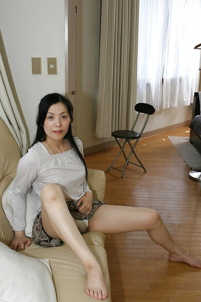 Seasoned Chinese lady Mari Inui striptease down and showcasing her hirsute gash