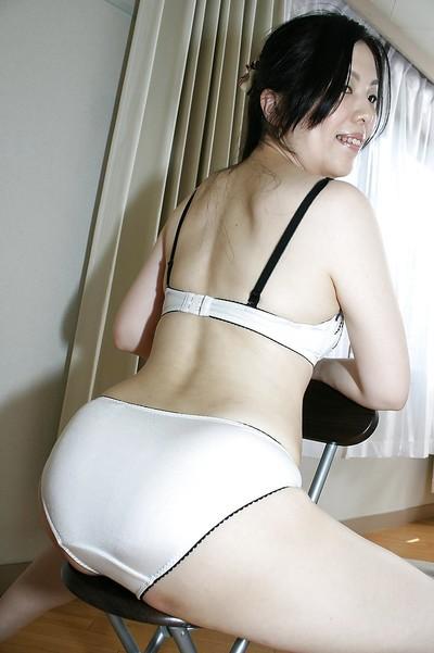 Seasoned Chinese lady Mari Inui striptease down and showcasing her hirsute gash
