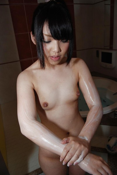 Oriental young delightsome bathroom and exposing her soapy cage of love in close up