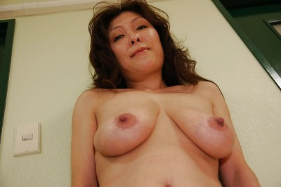 Rounded eastern MILF Masako Suzuki getting uncovered and swelling her below lips