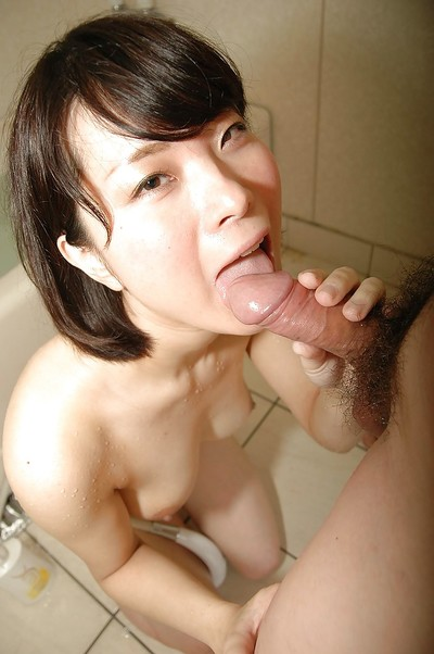 Captivating Japanese young gives a soggy hand and fellatio in the baths