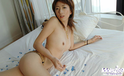 Sweet eastern girl with insignificant wobblers striptease off her strings
