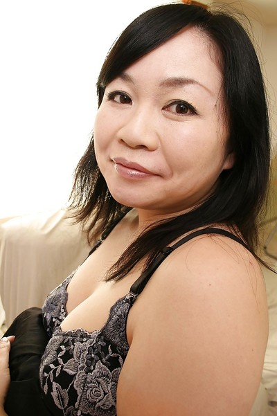 Shy titsy Japanese MILF Rumiko Shiga getting rid of her