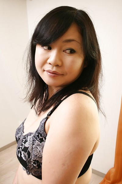 Shy titsy Japanese MILF Rumiko Shiga getting rid of her