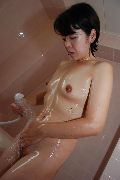 Sassy Chinese MILF with insignificant meatballs lovely washroom and exposing her gash