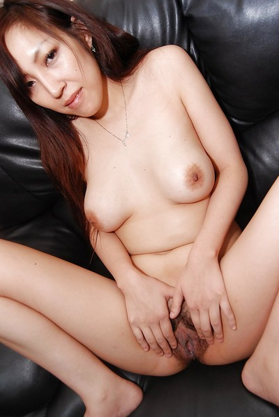 Extreme Japanese MILF purchases undressed down and purchases her hirsute bawdy cleft cheerful with sex-aids
