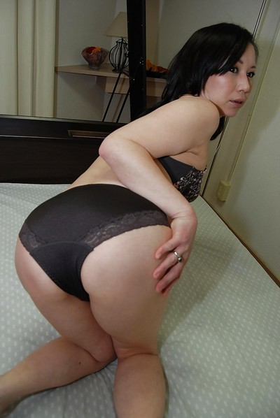 Sexual Japanese MILF in hose undressing and stretching her unshaved gash