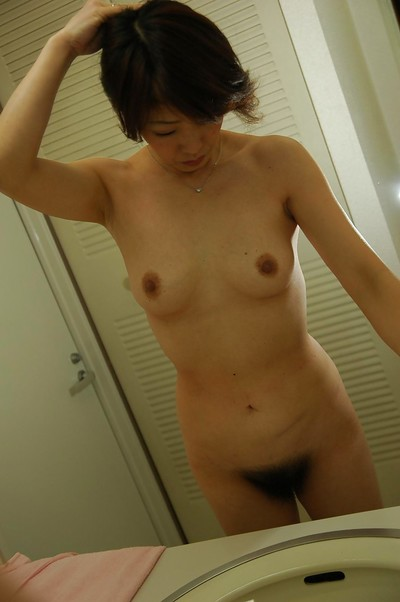 Oriental MILF Setsuko Miwa tempting baths and exposing her fuckable body