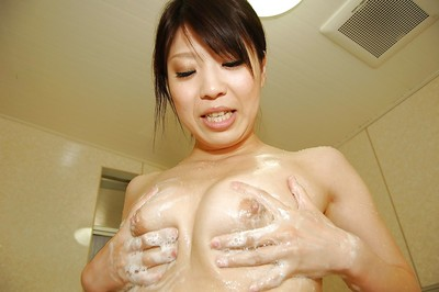 Japanese doll glorious bathroom and exposing her soapy goods in close up