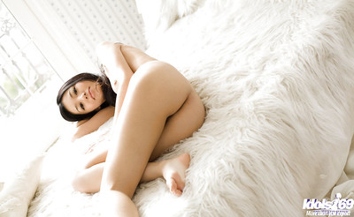 Gorgeous Japanese young vixen Aino Kishi uncovering her petite crooks