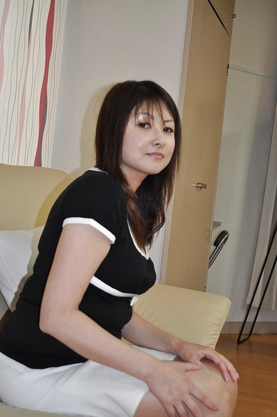 Yasuko Yoshii striptease and stroking her curly twat with a marital-device