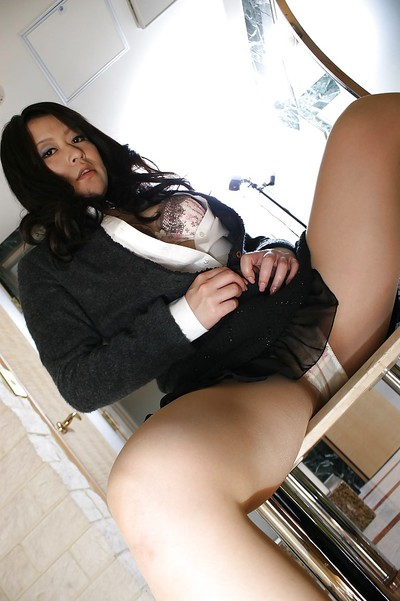 Shy Chinese MILF in suit clad undressing and exposing her unshaved gash