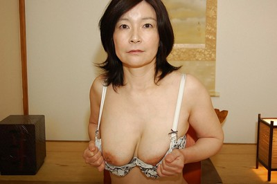Appealing Japanese seasoned lassie getting undressed and exposing her hairy gash